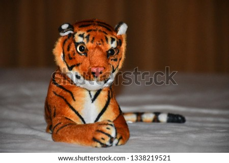 Cute Toy Tiger in the resort #1338219521