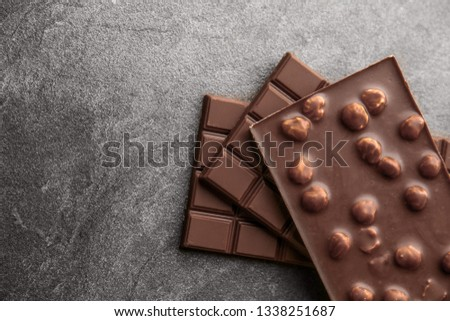Tasty milk chocolate on grunge background #1338251687