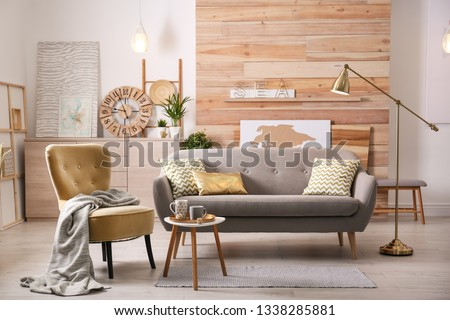 Stylish living room interior with comfortable sofa. Idea for home decor #1338285881