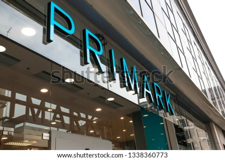 Glasgow / Great Britain - February 23, 2019: Exterior entrance to Primark fashion clothing store showing doors, logo and branding #1338360773