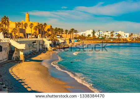 Monastir in Tunisia is an ancient city and popular tourist destination with a beach on the Mediterranean Sea. #1338384470