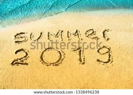 Summer 2018 nand drawn letters on yellow sand with blue sea paradise beach. Creative typography for Holiday Greeting Gift Poster  #1338496238