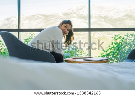 young woman sitting in the bedroom #1338542165