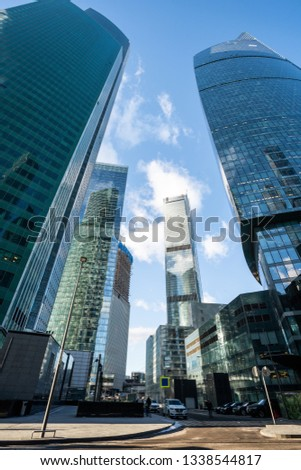 futuristic modern skyscrapers of glass and metal. Focus on buildings. toned photo #1338544817