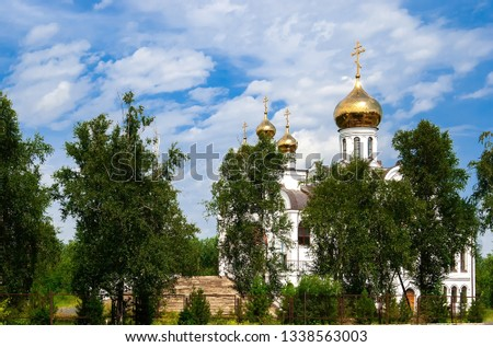summer landscape Orthodox Church Golden domes against blue sky and green trees #1338563003