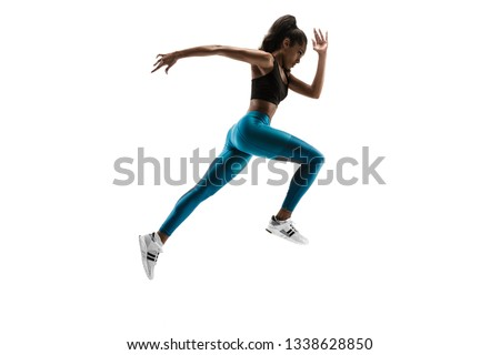Young african woman running isolated on white studio background. One female runner or jogger. Silhouette of jogging athlete #1338628850