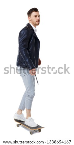 Front view of man with a skateboard. Rear view people collection. backside view of person.  Isolated over white background. Stylish guy in casual style rides a skateboard. #1338654167