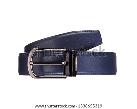 Rolled fashionable men's blue leather belt with dark matted metal buckle isolated on white Royalty-Free Stock Photo #1338655319