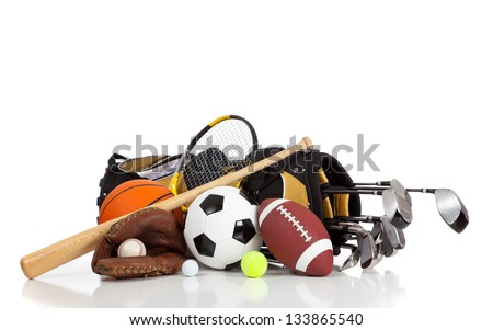 Assorted sports equipment on a white background with copy space Royalty-Free Stock Photo #133865540