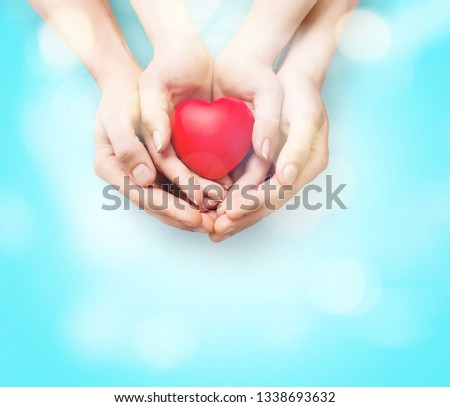 Man and woman holding red heart in hands isolated on white #1338693632