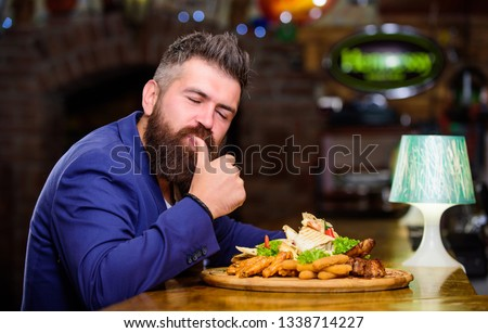 Businessman formal suit sit at restaurant. Man received meal with fried potato fish sticks meat. He deserve delicious meal. Enjoy your meal. High calorie snack. Delicious food. Relax after hard day. Royalty-Free Stock Photo #1338714227