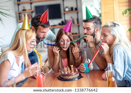Happy group of  friends celebrating birthday.