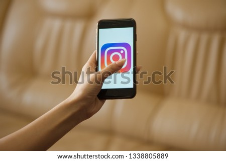 Saint-Petersburg / Russian Federation - 11 March 2019: Female hand holding cellphone with starting page of Instagram #1338805889