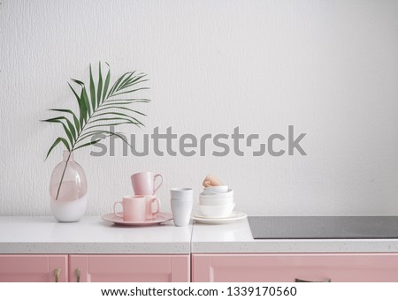 Set of tableware and modern stove in kitchen #1339170560