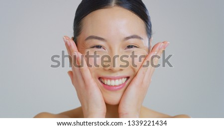 Portrait of asian woman with beautiful face with perfect skin just cleaned from impurities ready for day or night cream is smiling in camera.  #1339221434