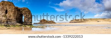 Panoramic shot of the golden sandy beach at  Perranporth Cornwall England UK Europe