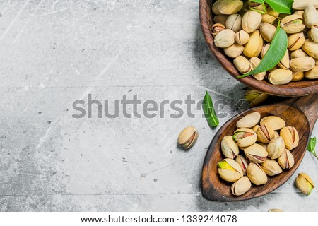Pistachios in the bowl. On a rustic background. #1339244078