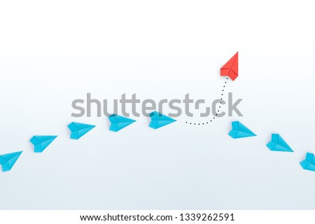 Business for new ideas creativity, innovative and solution concepts. Group of blue paper plane in one direction and one red paper plane pointing in different way on white background. copy space #1339262591