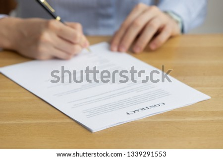 Close up woman signing contract, putting signature on official paper, hiring process, candidate filling job agreement, good deal, taking loan or purchase property, female hands holding writing pen #1339291553