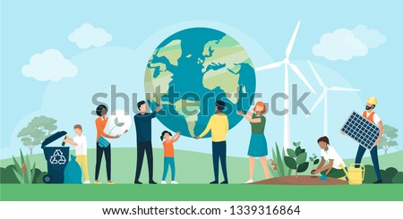 Multiethnic group of people cooperating for environmental protection and sustainability in a park: they are supporting earth together, recycling waste, growing plants and choosing renewable resources Royalty-Free Stock Photo #1339316864