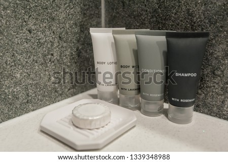toiletry bag with travel toiletries, small plastic bottles of hygiene products and soap, Hotel Guest Room Supplies Royalty-Free Stock Photo #1339348988