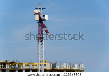 Construction of multi storey residential complex tower cranes in operation. as a rule, equipped with lifting ropes ropes or chains and bundles which can be used both for lifting and lowering materials #1339368506