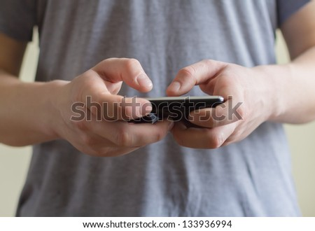 A man using a mobile phone #133936994