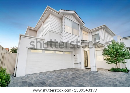 Front elevation / facade of a typical new modern double storey Australian style home. #1339543199