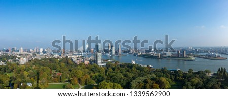 Panorama cityscape of Rotterdam, The Netherlands, with the city park in the foreground and financial district and city centre including the famous Erasmus bridge in the background #1339562900