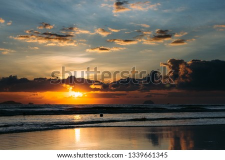Unforgettable sunrise by the sea on vacation  #1339661345
