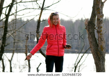 Young girl in pink jacket in autumn forest #1339688720