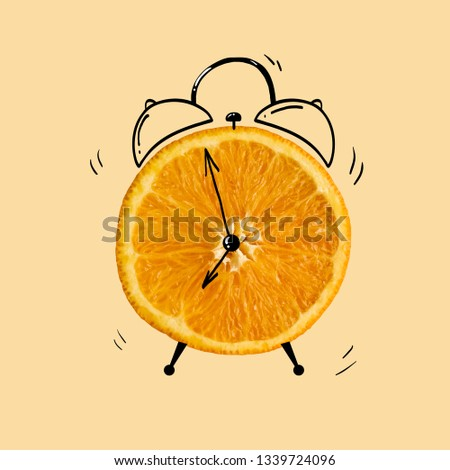 Creative idea layout fresh orange slice alarm clock on pastel orange background. minimal idea business creative concept. #1339724096