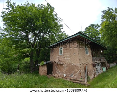 view of a traditional wooden house in a village in iran, guilan #1339809776