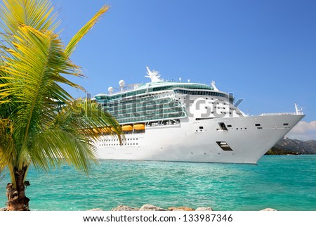Luxury Cruise Ship Sailing from Port Royalty-Free Stock Photo #133987346