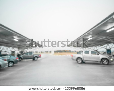 Abstract blurred parking cars in department store. #1339968086