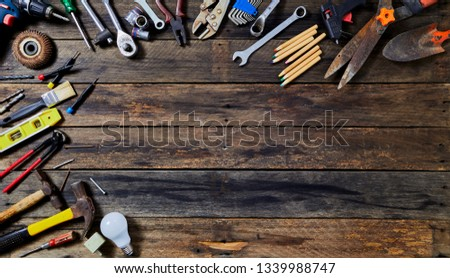 Happy 1st MAY Labour Day word Labor day variety of occupations Construction Many tools a Copy space for text on rustic wooden background. Worker's, Labor's , labour's #1339988747