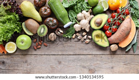 Healthy food. Selection of vegetables, fruits, nuts and cereals for ketogenic diet, clean eating, plant based, vegetarian and super food concept. Royalty-Free Stock Photo #1340134595