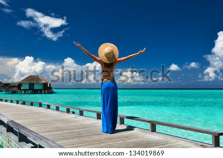 Woman on a tropical beach jetty at Maldives #134019869