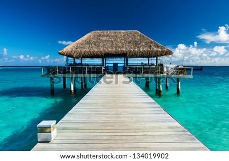 Beautiful beach with jetty at Maldives #134019902