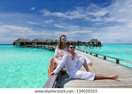 Couple on a tropical beach jetty at Maldives #134020319