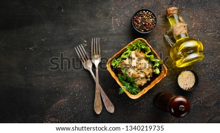 Mushrooms in sour cream sauce with onions and spices. on rustic background, top view, banner. #1340219735