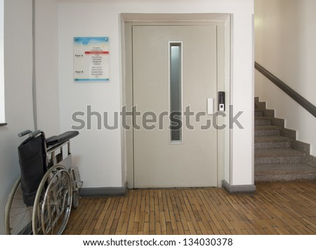 Entrance foyer in a medical centre with elevator and wheelchair