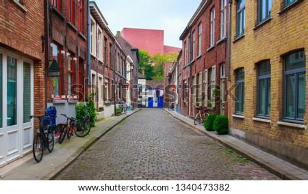 Bruges, Belgium-05.05.2018: Old streets, old houses. City break. Traditional belgian. #1340473382