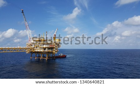 Supply boat support oil and gas industry.Supply boat transfer cargo to oil and gas industry and moving cargo from the boat to the platform. Boat is waiting to transfer cargo and crews to platform.  #1340640821