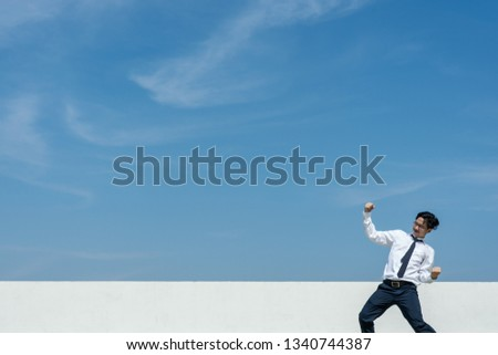 Successful concept. Businessman expressing to celebrate his success. #1340744387