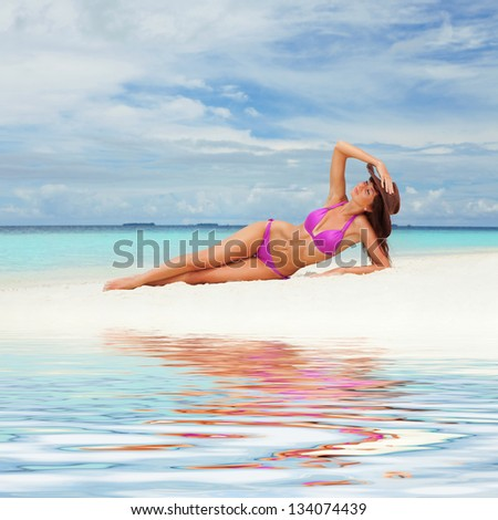 Cute woman relaxing on the beach #134074439