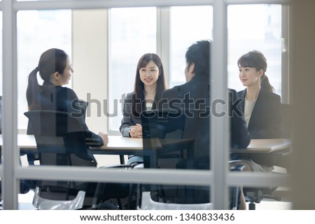 Group of businessperson meeting in office. #1340833436