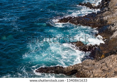 beautiful view on blue ocean water and rocky coast line #1340861633