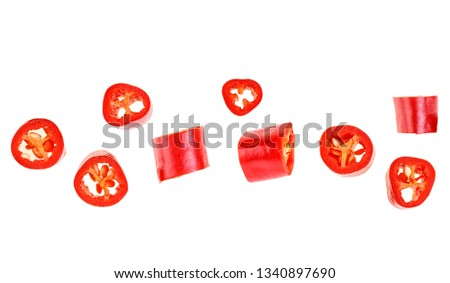 Red chopped chili peppers on white background. Top view. #1340897690