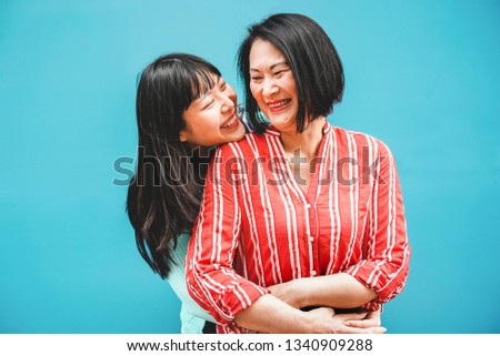 Asian mother and daughter having fun outdoor - Happy family people enjoying time togehter - Love, parenthood lifestyle, tender moments concept - Focus on faces #1340909288